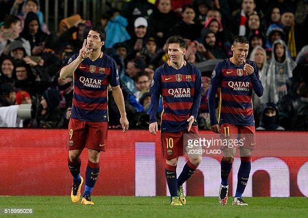 Barcelona's Uruguayan forward Luis Suarez celebrates his goal with Barcelona's Argentinian forward Lionel Messi and Barcelona's Brazilian forward...