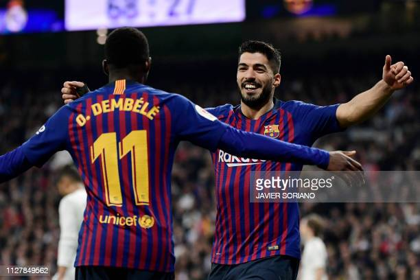 Barcelona's Uruguayan forward Luis Suarez celebrates his second goal with Barcelona's French forward Ousmane Dembele during the Spanish Copa del Rey...