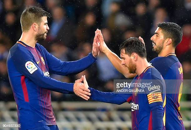 TOPSHOT Barcelona's Uruguayan forward Luis Suarez celebrates his second goal with Barcelona's Argentinian forward Lionel Messi and Barcelona's...