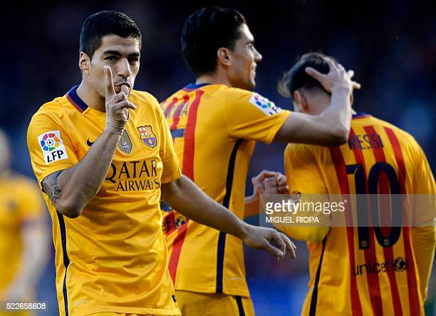 Barcelona's Uruguayan forward Luis Suarez celebrates his third goal during the Spanish league football match RC Deportivo de la Coruna vs FC...