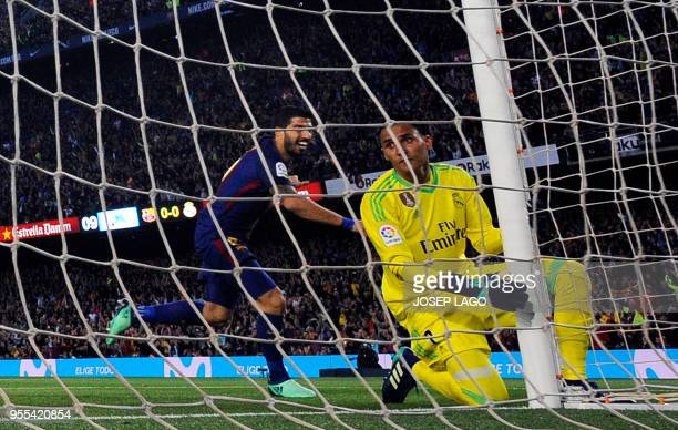 Barcelona's Uruguayan forward Luis Suarez celebrates scoring a goal beside Real Madrid's Costa Rican goalkeeper Keylor Navas during the Spanish...