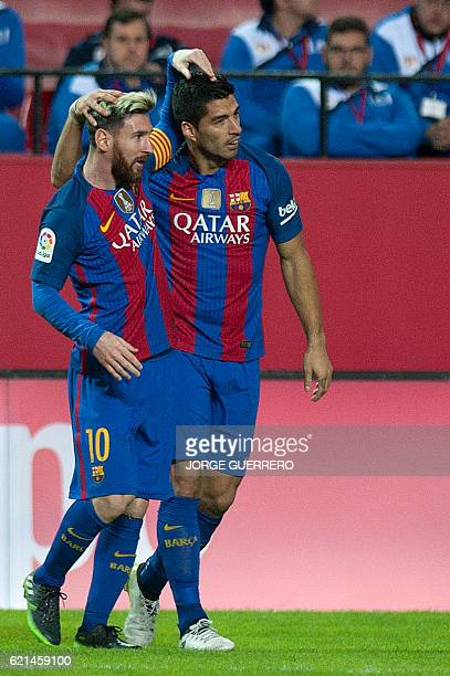 Barcelona's Uruguayan forward Luis Suarez celebrates with Argentinian forward Lionel Messi after scoring during the Spanish league football match...