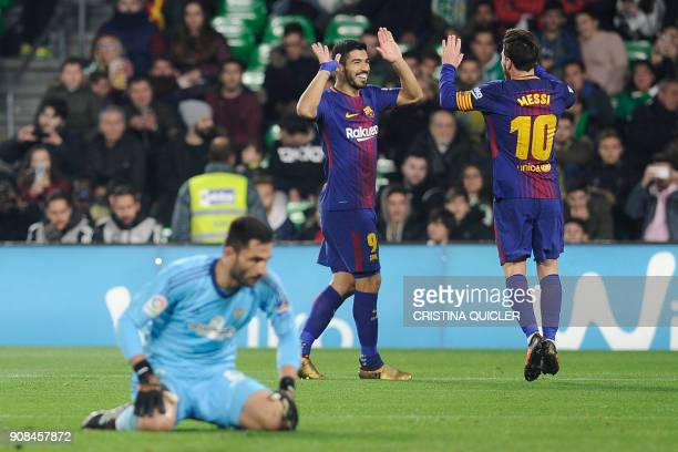 Barcelona's Uruguayan forward Luis Suarez celebrates with Argentinian forward Lionel Messi after scoring a goal during the Spanish league football...