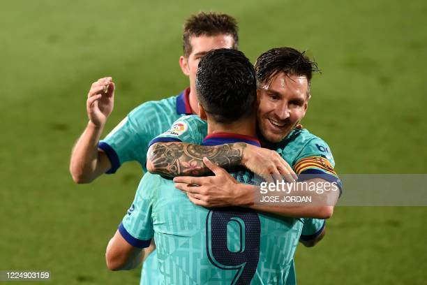 Barcelona's Uruguayan forward Luis Suarez celebrates with Barcelona's Argentine forward Lionel Messi and Barcelona's Spanish defender Sergi Roberto...