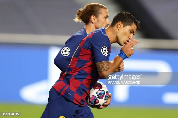 Barcelona's Uruguayan forward Luis Suarez celebrates with Barcelona's French forward Antoine Griezmann after scoring a goal during the UEFA Champions...