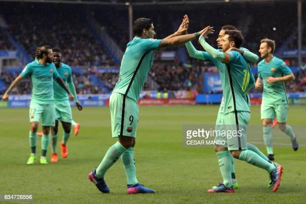 Barcelona's Uruguayan forward Luis Suarez celebrates with Barcelona's Argentinian forward Lionel Messi and Barcelona's Brazilian forward Neymar...