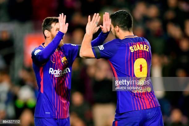 Barcelona's Uruguayan forward Luis Suarez celebrates with Barcelona's Argentinian forward Lionel Messi after scoring during the Spanish league...