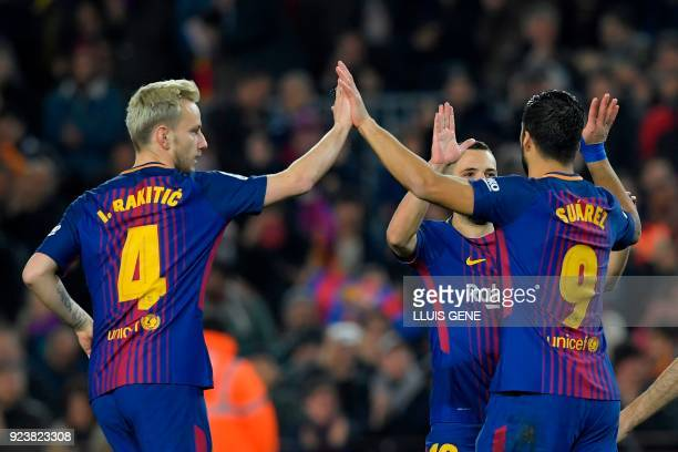 Barcelona's Uruguayan forward Luis Suarez celebrates with Barcelona's Croatian midfielder Ivan Rakitic and Barcelona's Spanish defender Jordi Alba...