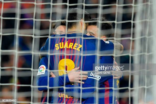 Barcelona's Uruguayan forward Luis Suarez celebrates with Barcelona's Argentinian forward Lionel Messi and Barcelona's Brazilian midfielder Philippe...