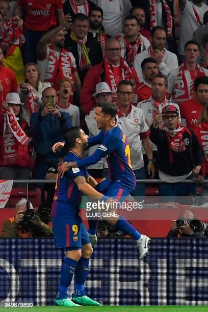 Barcelona's Uruguayan forward Luis Suarez celebrates with Barcelona's Brazilian midfielder Philippe Coutinho after scoring during the Spanish Copa...