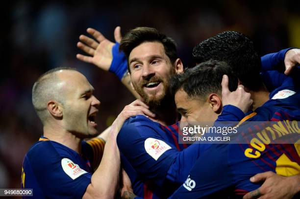TOPSHOT Barcelona's Uruguayan forward Luis Suarez celebrates with Barcelona's Spanish midfielder Andres Iniesta Barcelona's Argentinian forward...