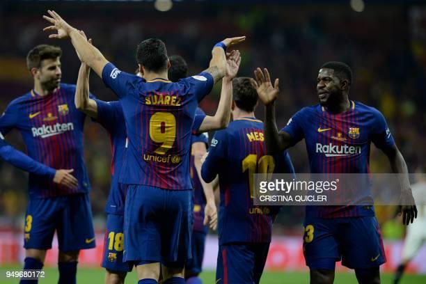 Barcelona's Uruguayan forward Luis Suarez celebrates with Barcelona's Spanish defender Jordi Alba and Barcelona's French defender Samuel Umtiti after...
