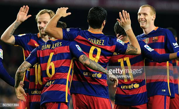 Barcelona's Uruguayan forward Luis Suarez celebrates with teammates after scoring during the Spanish league football match FC Barcelona vs Real Betis...