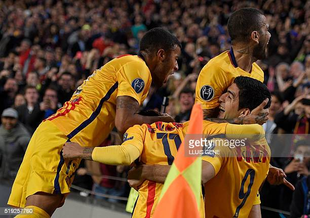Barcelona's Uruguayan forward Luis Suarez celebrates with teammates after scoring a goal during the UEFA Champions League quarter finals first leg...