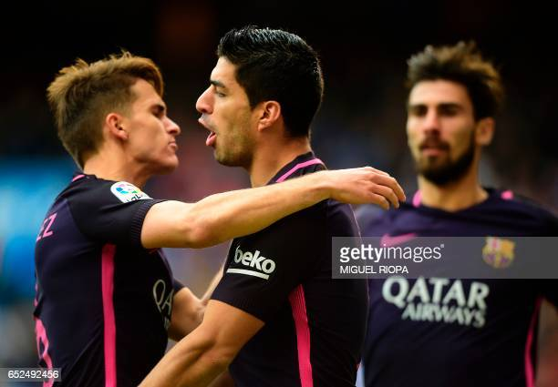 Barcelona's Uruguayan forward Luis Suarez celebrates with teammates after scoring during the Spanish league football match Deportivo la Coruna vs FC...