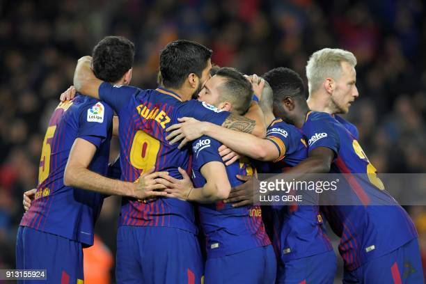Barcelona's Uruguayan forward Luis Suarez celebrates with teammates after scoring during the Spanish 'Copa del Rey' first leg semifinal football...