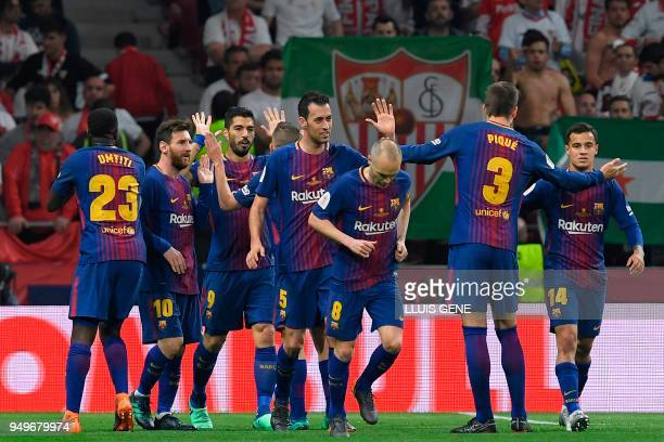 Barcelona's Uruguayan forward Luis Suarez celebrates with teammates after scoring during the Spanish Copa del Rey final football match Sevilla FC...
