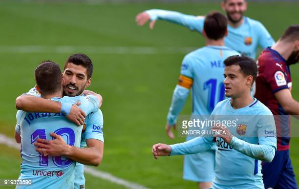 Barcelona's Uruguayan forward Luis Suarez congratulates Barcelona's Spanish defender Jordi Alba for his goal while Barcelona's Brazilian midfielder...