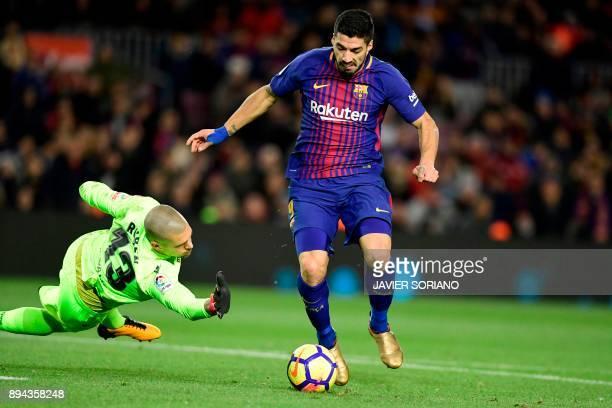 Barcelona's Uruguayan forward Luis Suarez controls the ball in front of Deportivo La Coruna's Spanish goalkeeper Ruben during the Spanish league...