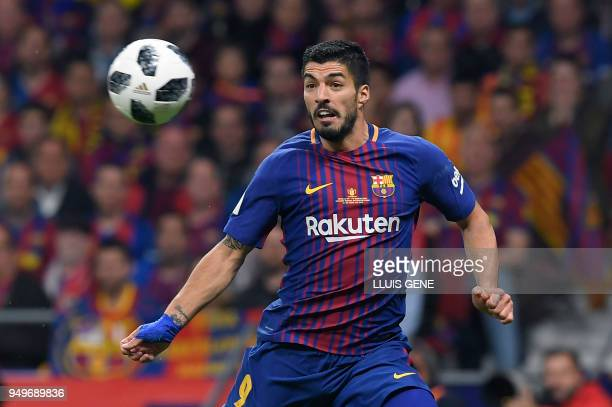 Barcelona's Uruguayan forward Luis Suarez eyes the ball during the Spanish Copa del Rey final football match Sevilla FC against FC Barcelona at the...