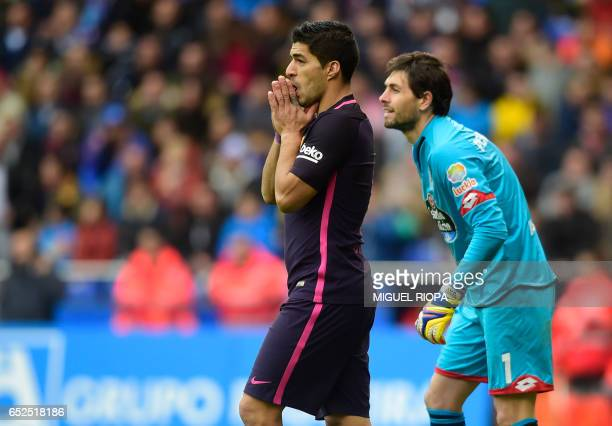 Barcelona's Uruguayan forward Luis Suarez gestures beside Deportivo La Coruna's Argentinian goalkeeper German Dario Lux after missing a goal during...