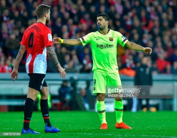 Barcelona's Uruguayan forward Luis Suarez gestures next to Athletic Bilbao's Spanish defender Inigo Martinez during the Spanish league football match...