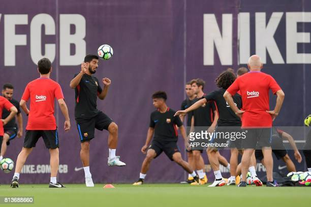Barcelona's Uruguayan forward Luis Suarez heads a ball during a training session at the Sports Center FC Barcelona Joan Gamper in Sant Joan Despi...