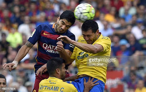 Barcelona's Uruguayan forward Luis Suarez heads the ball to score a goal during the Spanish league football match FC Barcelona vs UD Las Palmas at...