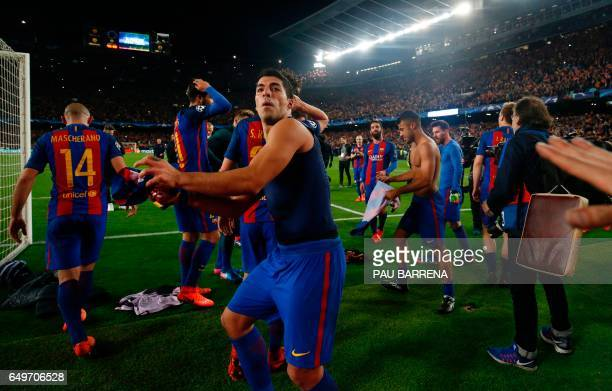 Barcelona's Uruguayan forward Luis Suarez is about to throw his tshirt to fans as he celebrates their 61 victory at the end of the UEFA Champions...