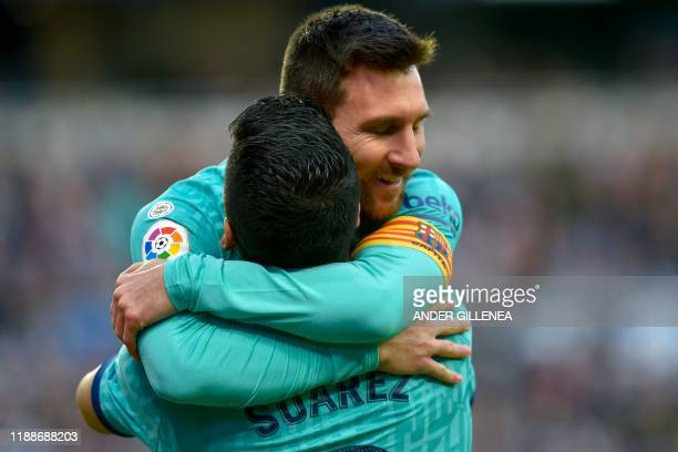 Barcelona's Uruguayan forward Luis Suarez is congratulated by Barcelona's Argentine forward Lionel Messi after scoring a goal during the Spanish...