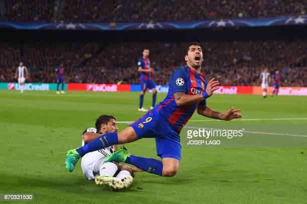 TOPSHOT Barcelona's Uruguayan forward Luis Suarez is tackled by Juventus' German midfielder Sami Khedira during the UEFA Champions League...