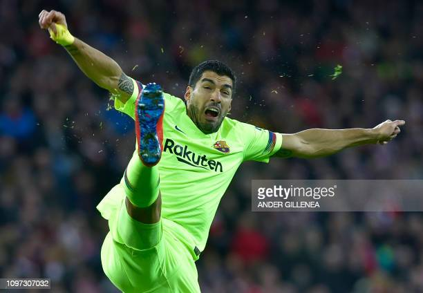 Barcelona's Uruguayan forward Luis Suarez jumps for the ball during the Spanish league football match Athletic Club Bilbao against FC Barcelona at...