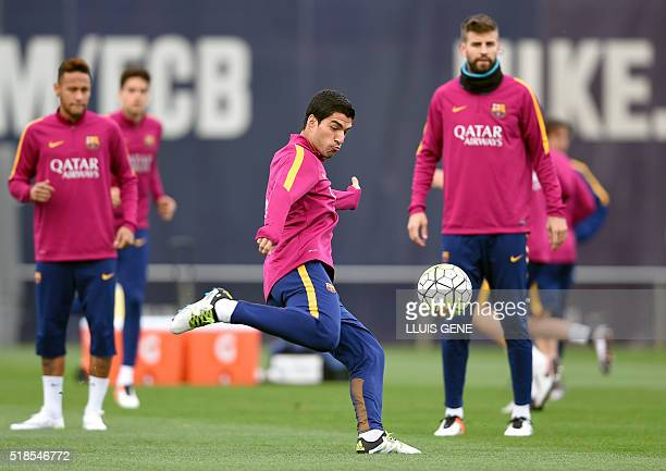 Barcelona's Uruguayan forward Luis Suarez kicks a ball during a training session at the Sports Center FC Barcelona Joan Gamper in Sant Joan Despi,...