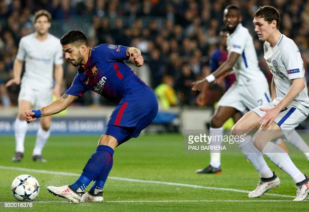 Barcelona's Uruguayan forward Luis Suarez kicks the ball beside Chelsea's Danish defender Andreas Christensen during the UEFA Champions League round...