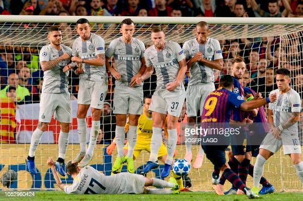 TOPSHOT Barcelona's Uruguayan forward Luis Suarez kicks the ball during the UEFA Champions League group B match Barcelona against Inter Milan at the...