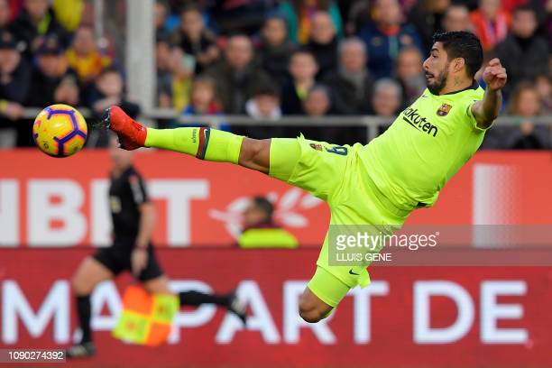 TOPSHOT Barcelona's Uruguayan forward Luis Suarez kicks the ball during the Spanish league football match between Girona FC and FC Barcelona at the...