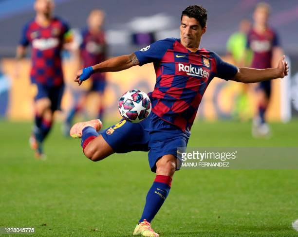 Barcelona's Uruguayan forward Luis Suarez kicks the ball during the UEFA Champions League quarter-final football match between Barcelona and Bayern...