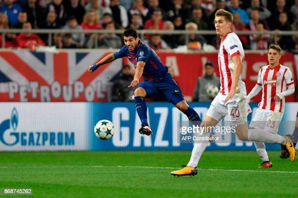Barcelona's Uruguayan forward Luis Suarez kicks the ball during the UEFA Champions League group D football match between FC Barcelona and Olympiakos...