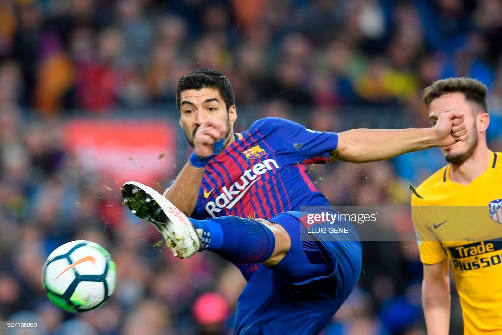 TOPSHOT - Barcelona's Uruguayan forward Luis Suarez kicks the ball during the Spanish league football match FC Barcelona against Club Atletico de Madrid at the Camp Nou stadium in Barcelona on March 04, 2018. /