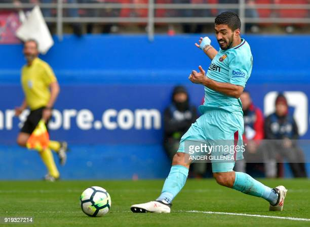 Barcelona's Uruguayan forward Luis Suarez kicks the ball to score a goal during the Spanish league football match between SD Eibar and FC Barcelona...