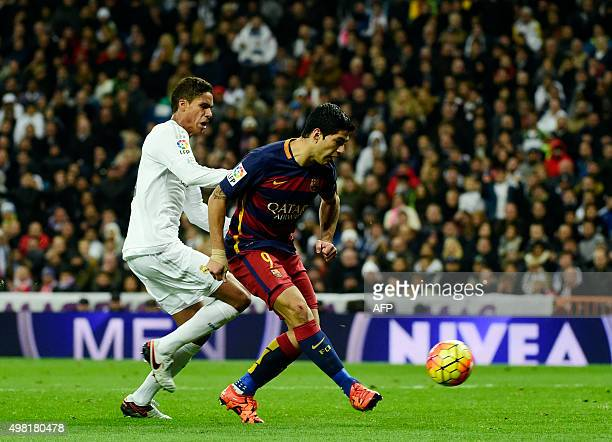 Barcelona's Uruguayan forward Luis Suarez kicks to score the Spanish league 'Clasico' football match Real Madrid CF vs FC Barcelona at the Santiago...