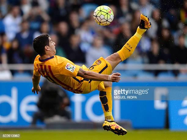 Barcelona's Uruguayan forward Luis Suarez performs a scissor kick during the Spanish league football match RC Deportivo de la Coruna vs FC Barcelona...