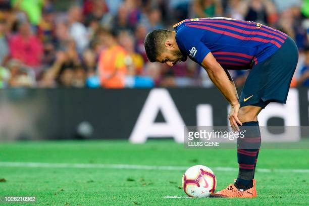 Barcelona's Uruguayan forward Luis Suarez prepares to take a penalty kick during the Spanish league football match between FC Barcelona and SD Huesca...