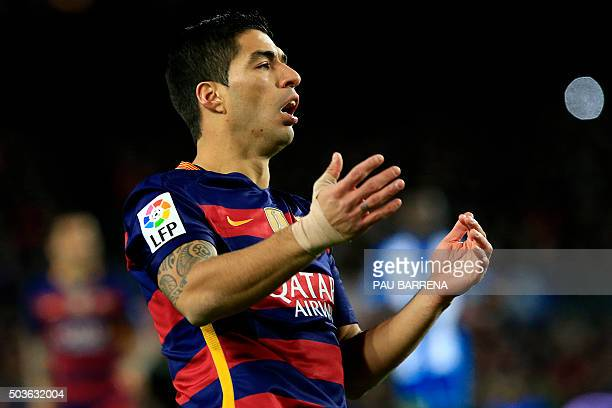 Barcelona's Uruguayan forward Luis Suarez reacts after missing a goal opportunity during the Spanish Copa del Rey round of 16 first leg football...