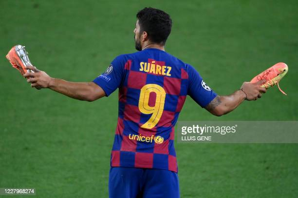 Barcelona's Uruguayan forward Luis Suarez reacts at the end of the UEFA Champions League round of 16 second leg football match between FC Barcelona...