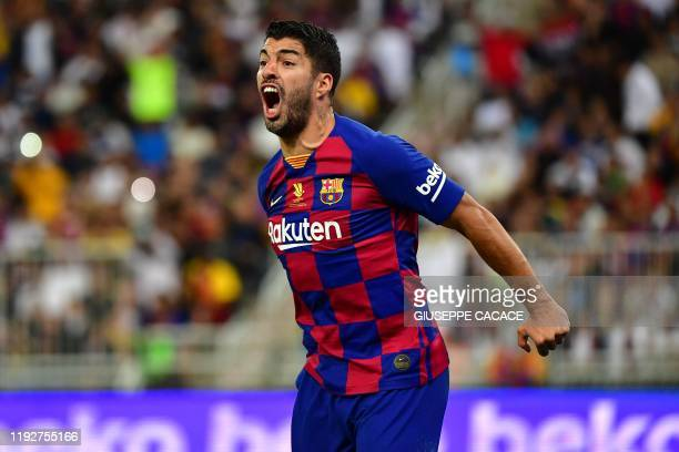 Barcelona's Uruguayan forward Luis Suarez reacts during the Spanish Super Cup semi final between Barcelona and Atletico Madrid on January 9 at the...