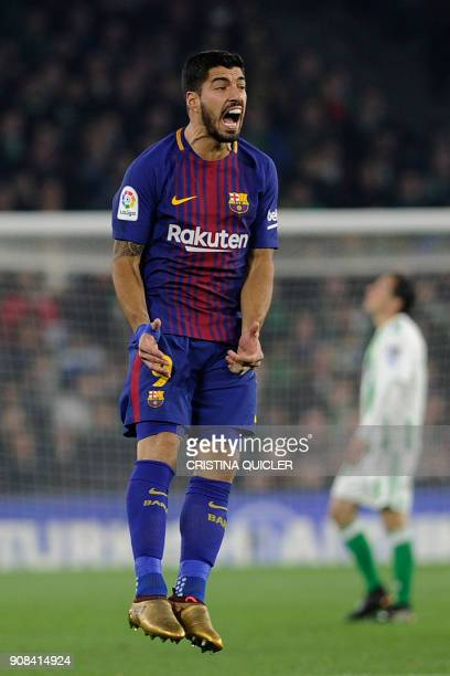 Barcelona's Uruguayan forward Luis Suarez reacts during the Spanish league football match between Real Betis and FC Barcelona at the Benito...