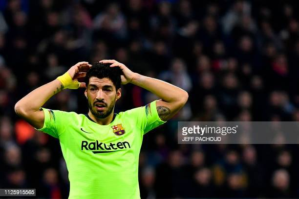 Barcelona's Uruguayan forward Luis Suarez reacts during the UEFA Champions League round of 16 first leg football match between Lyon and FC Barcelona...