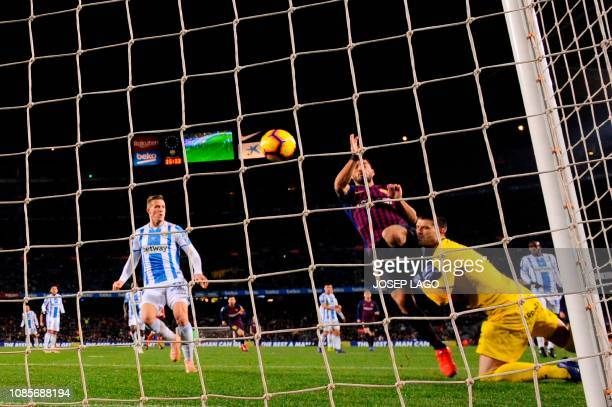 Barcelona's Uruguayan forward Luis Suarez scores a goal against Leganes' Spanish goalkeeper Pichu Cuellar during the Spanish League football match...