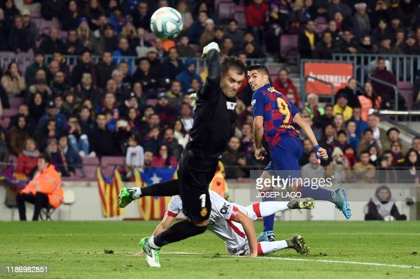 TOPSHOT Barcelona's Uruguayan forward Luis Suarez scores a goal during the Spanish League football match between FC Barcelona and RCD Mallorca at the...